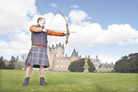 Ross Boardman of Boots N Paddles teaches archery on the front lawn of Glamis Castle (the childhood home of the late Queen Mother) as part of Adventures by Disney's A Brave Adventure tour of Scotland.