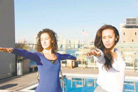 Yoga on the rooftop with Brigette Bourdeau and Millana Snow.