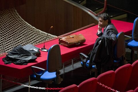 Captain Francesco Schettino waits for the start of his trial in the court room of the converted Teatro Moderno theater, in Grosseto, Italy, Wednesday, July 17, 2013. The trial of the captain of the shipwrecked Costa Concordia cruise liner, accused of multiple manslaughter, abandoning ship and causing the shipwreck near the island of Giglio, has begun in a theater converted into a courtroom in Tuscany to accommodate all the survivors and relatives of the 32 victims who want to see justice carried out in the 2012 tragedy. The trial, which was supposed to get under way July 9, was postponed until Wednesday due to a lawyers' strike. (AP Photo/Andrew Medichini)
