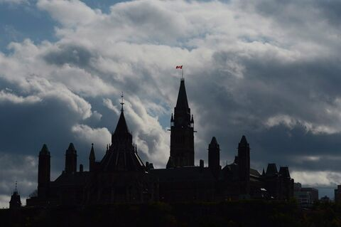 Clouds form a backdrop for the buildings on Parliament Hill in Ottawa on Tuesday, Oct. 22, 2013. MPs return to Parliament on Monday with the spectre of the Senate expenses scandal still hovering over the Harper government. THE CANADIAN PRESS/Sean Kilpatrick