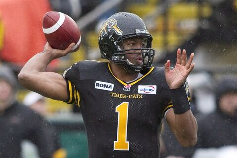 Hamilton Tiger-Cats quarterback Henry Burris throws a touchdown during first half CFL action against Winnipeg Blue Bombers in Hamilton on Saturday October 27, 2012. It seems that age is but a state of mind for Canadian Football League quarterbacks.Two of the best, Anthony Calvillo of the Montreal Alouettes and Burris, are 40 and 38 respectively heading into the 2013 season.THE CANADIAN PRESS/ Chris Young