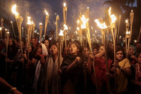 Bangladeshi activists shout slogans as they participate in a torch rally in Dhaka, Bangladesh, Thursday, Dec. 12, 2013. Bangladesh's Supreme Court cleared the way Thursday for the execution of opposition Jamaat-e-Islami leader Abdul Quader Mollah convicted of war crimes, rejecting a last-minute appeal in a case that threatens to spark fresh violence ahead of national elections next month. Mollah, 65, was convicted of war crimes committed during the nation's war of independence against Pakistan in 1971. (AP Photo/A.M. Ahad)