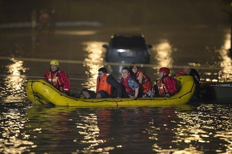 Stranded passengers are rescued from a flooded GO Train in Toronto on Monday, July 8, 2013. THE CANADIAN PRESS/Frank Gunn