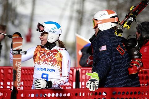 United States' Julia Mancuso talks to a teammate in the finish area after a women's downhill training run for the 2014 Winter Olympics, Thursday, Feb. 6, 2014, in Krasnaya Polyana, Russia. (AP Photo/Gero Breloer)