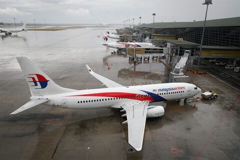 A Malaysia Airlines Boeing 737-800 plane sits on tarmac at Kuala Lumpur International Airport in Sepang, Malaysia, Friday, Aug. 8, 2014. Malaysia's state investment company said Friday it plans to make Malaysia Airlines fully government owned, removing it from the country's stock exchange before carrying out a far-reaching overhaul of the carrier that is reeling from double disasters. (AP Photo/Vincent Thian)