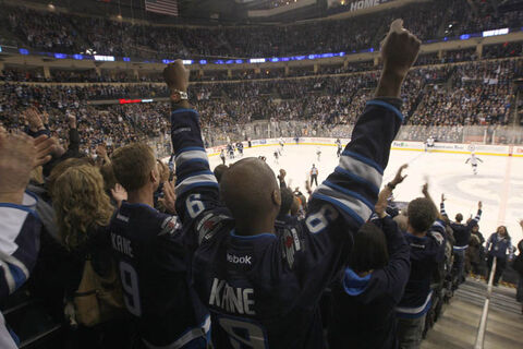Winnipeg Jets fans celebrate 4-2 win over the Pittsburgh Penguins Friday night at the MTS Centre in Winnipeg.