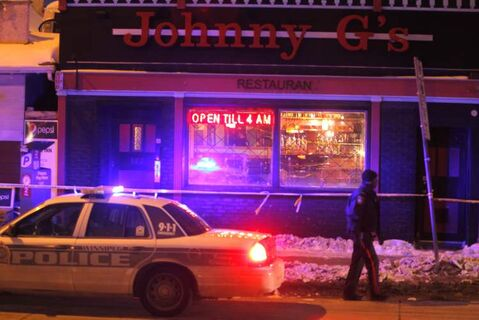 Police investigate the shooting at Johnny G's late-night restaurant on Main Street on February 15.