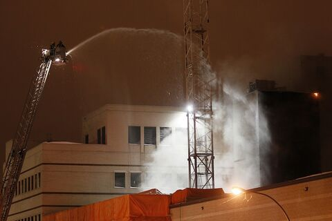 Firefighters fight a fire in the wing of the Children's Hospital currently under construction Tuesday, March 5, 2013.