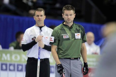 Mike McEwen (right) and his team defeated Jeff Stoughton's rink 9-6 Thursday night, ending Stoughton's chances of representing Canada at the Olympics in 2014.