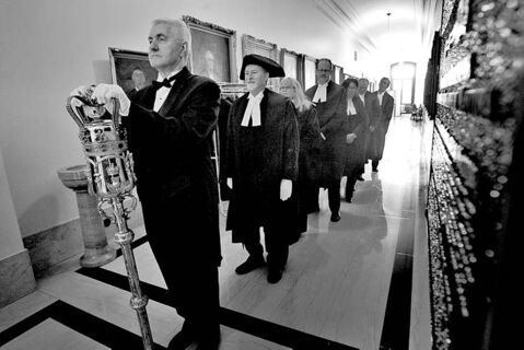 Sergeant-at-arms Blake Dunn, followed by Speaker Daryl Reid and other officials, carries the mace into the legislative chamber Monday.