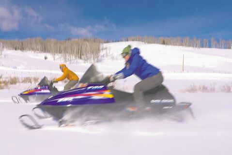 Guests at Jackson Fork Ranch can choose from a wide variety of outdoor activities such as snowmobiling and snowshoeing.
