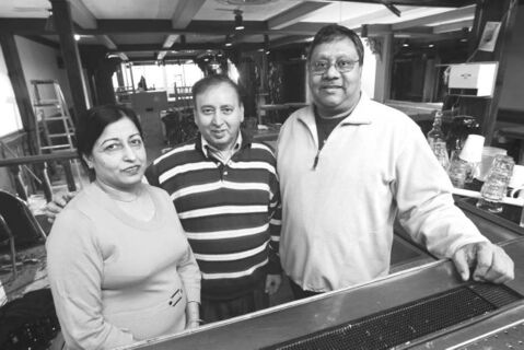 Owners of the India Palace Ashwani Nagpal (centre), wife, Suroj, and Manny Singh from Sovereign Construction Ltd., inside the former Lo Pub.