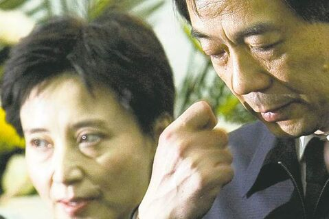 Then-Chinese commerce minister Bo Xilai, right, with his wife Gu Kailai in 2007.