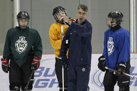 Winnipeg Jets head coach Claude Noel passes on pearls of wisdom to members of the Winnipeg Monarchs bantam team during a practice at the MTS Iceplex Monday.