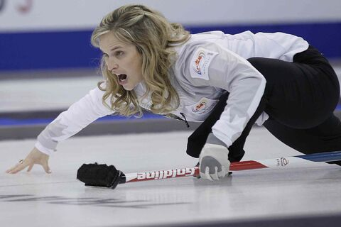 Skip Jennifer Jones calls to her sweepers in draw 7 against Renee Sonnenberg at the 2013 Roar Of The Rings championship in Winnipeg, Tuesday.