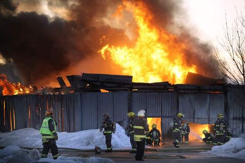 Flames shoot from a shed on the Canad Inns Stadium property on Tuesday evening. Firefighters took precautions after they discovered two large fuel containers on the site. The shed is a total loss.