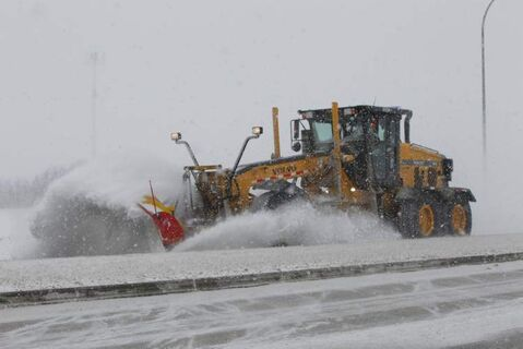 A grader works on the west Perimeter Highway this morning.