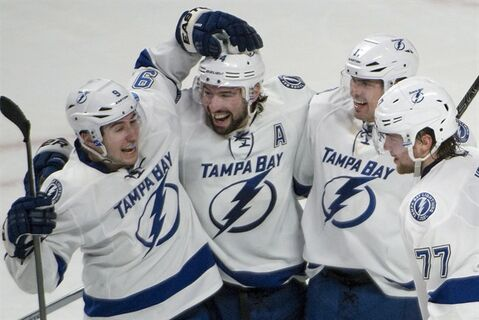 Tampa Bay Lightning Nate Thompson, 2nd from left, celebrates his overtime goal against the Montreal Canadiens during NHL action in Montreal Saturday, February 1, 2014. THE CANADIAN PRESS/Peter McCabe