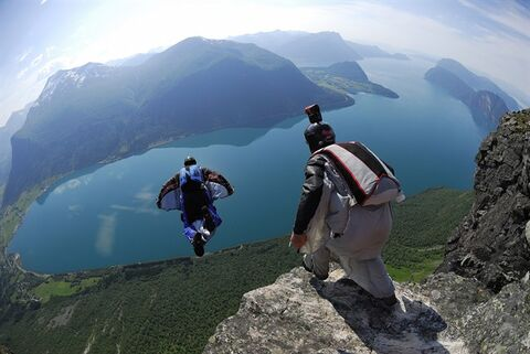 Jay Moledzki (left) and Jim Mitchell jump from Gridset in Innfjorden, Norway in a handout photo released on Thursday July 17, 2014. THE CANADIAN PRESS/HO - Muse Ent., Atle Dahl