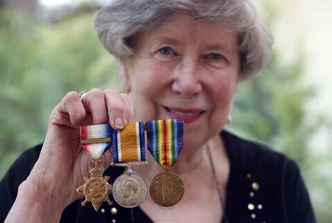 Mildred Wright has her father Carl Rosenberg's medals from the First World War along with a photo of him and his brother in uniform.