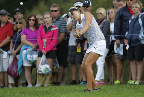 Lexi Thompson hits from the rough to the green on the sixth hole during the second round of the LPGA Championship golf tournament, Friday, Aug. 15, 2014, in Pittsford, N.Y. (AP Photo/Democrat & Chronicle, Shawn Dowd)