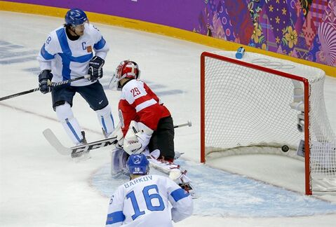 Finland forward Teemu Selanne (8) watches as the puck slips past Austria goaltender Bernhard Starkbaum for a goal in the first period of a men's ice hockey game at the 2014 Winter Olympics, Thursday, Feb. 13, 2014, in Sochi, Russia. (AP Photo/Mark Humphrey)