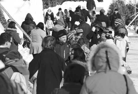 Large numbers of people take in the final day of the 2013 Festival du Voyageur on Feb. 24.