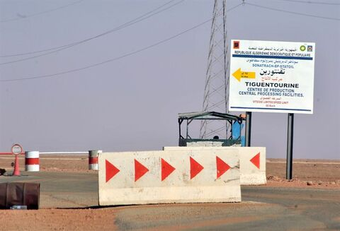 Roadblocks prevent the access of the Tigentourine gas plant where hostages have been kidnapped by islamic militants, Friday, Jan. 18, 2013. The hostage crisis in the remote desert of Algeria is not over, Britain said Friday, after an Algerian raid on the gas plant to wipe out Islamist militants and free their captives from at least 10 countries unleashed bloody chaos. (AP Photo/Anis Belghoul)