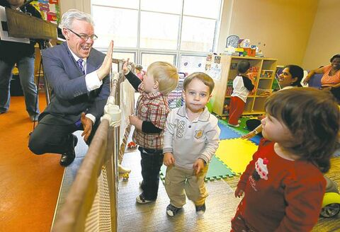 Premier Greg Selinger, at Morrow Avenue Child Care Centre, wants to create 2,000 additional spots.