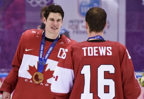 Men's hockey gold medallist Sidney Crosby celebrates with teammate Jonathan Toews after beating Sweden 3-0 in the final at the Sochi Winter Olympics Sunday, February 23, 2014 in Sochi. THE CANADIAN PRESS/Paul Chiasson