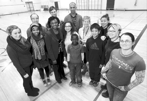 Teachers and members of the Boys and Girls Club who are volunteering to assist in a nationwide study linking fitness and literacy organized by Start2Finish at Sister MacNamara Elementary School.