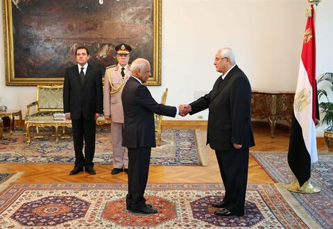 This image released by the Egyptian Presidency on Tuesday, July 16, 2013 shows interim President Adly Mansour, right, shaking hands with Prime Minister Hazem el-Biblawi during a sweararing-in ceremony for new cabinet ministers at the presidential palace in Cairo, Egypt. Egypt's interim president has sworn in a new Cabinet, the first since the ouster of the Islamist president by the military nearly two weeks ago. The new government, sworn in Tuesday, is led by Prime Minister Hazem el-Beblawi, an economist, and features the promotion of Defence Minister Gen. Abdel-Fattah el-Sissi, who ousted Mohammed Morsi on July 3, to deputy prime minister. He also retains the defence portfolio. (AP Photo/Egyptian Presidency)