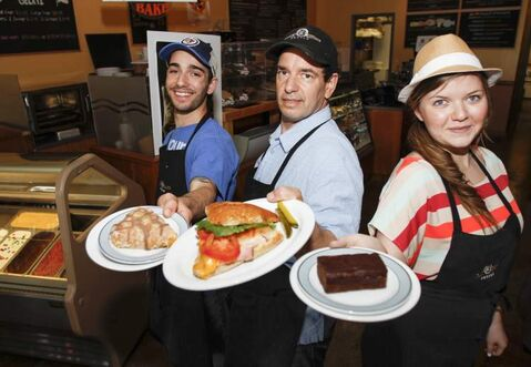 Daily Grind owner Tom Paquette (centre) shows off some of the shop's fares with baristas Matt Paquette (left) and Shannon Jansen.