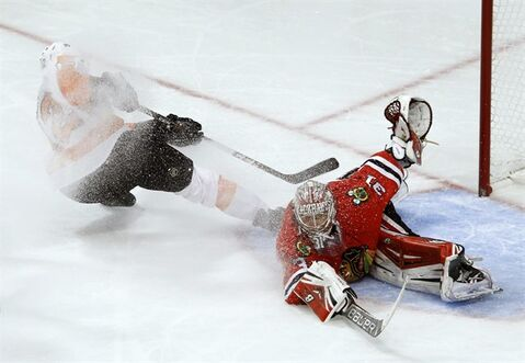 Chicago Blackhawks goalie Antti Raanta (31) makes a save on a breakaway, short-handed shot by Philadelphia Flyers left wing Michael Raffl during the third period of an NHL hockey game on Wednesday, Dec. 11, 2013, in Chicago. The Blackhawks won 7-2. (AP Photo/Charles Rex Arbogast)