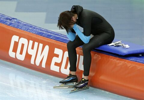 Heather Richardson of the U.S. cups her face and looks down after competing in the women's 1,500-meter race at the Adler Arena Skating Center during the 2014 Winter Olympics in Sochi, Russia, Sunday, Feb. 16, 2014. (AP Photo/Matt Dunham)