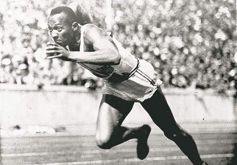 This 1936  file photo  shows Owens  in action  in a 200-metre preliminary  heat at the  Summer Olympic Games in Berlin.