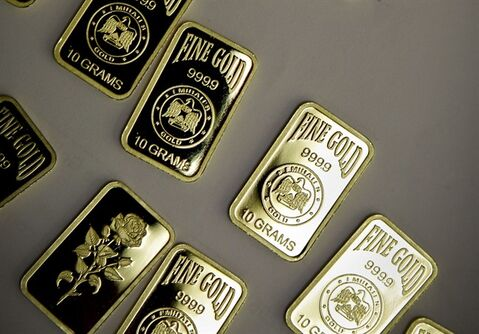 FILE - In this Tuesday Oct. 9, 2012 file photo, 10 gram gold bars with a purity of 999.9 have been pressed and stamped with the