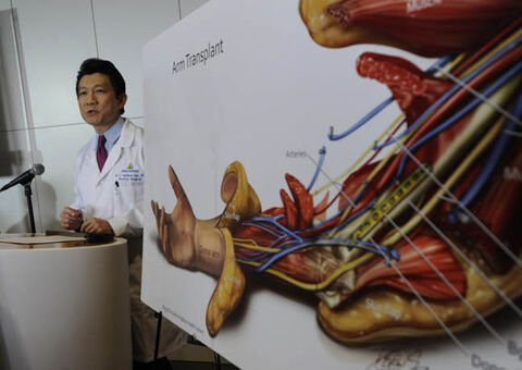 W.P. Andrew Lee, M.D. talks about the bilateral arm transplant on Infantryman Brendan M. Marocco during a news conference Tuesday, Jan. 29. 2013 at Johns Hopkins hospital in Baltimore.