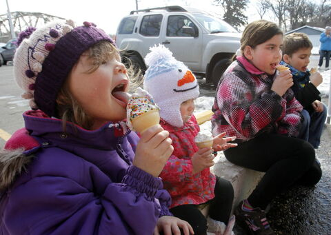 Danika, 3, sister Deah, 18 months, Austyn, 8, and her brother Thayne, 6 (from left), get in their licks at the Bridge Drive-In on Jubilee Avenue on Friday, enjoying their ice cream as the weather warms.