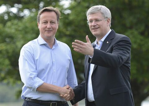 British Prime Minister David Cameron officially welcomes Canadian Prime minister Stephen Harper to the G8 Summit at Lough Erne, Northern Ireland, Monday, June 17, 2013. THE CANADIAN PRESS/Adrian Wyld