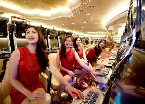 Casino models pose at slot machines at the new Solaire Resort and Casino in suburban Pasay, south of Manila, Philippines.