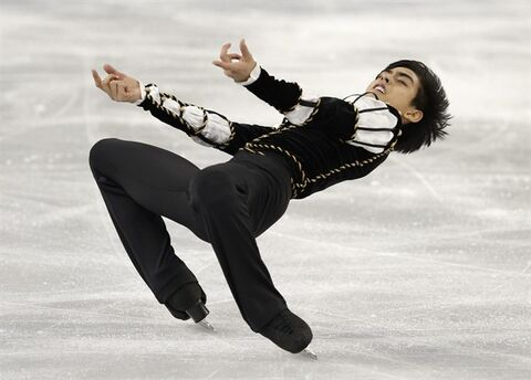 Michael Christian Martinez of the Philippines competes in the men's short program figure skating competition at the Iceberg Skating Palace during the 2014 Winter Olympics, Thursday, Feb. 13, 2014, in Sochi, Russia. (AP Photo/Darron Cummings)