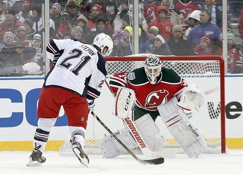 New York Rangers center Derek Stepan (21) takes a penalty shot against New Jersey Devils goalie Martin Brodeur (30) in the third period of an NHL outdoor hockey game at Yankee Stadium in New York, Sunday, Jan. 26, 2014. The Rangers won 7-3. (AP Photo/Kathy Willens)