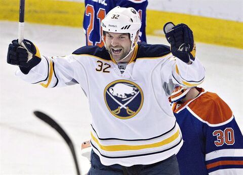 Buffalo Sabres' John Scott (32) celebrate the goal against the Edmonton Oilers during second period NHL hockey action in Edmonton, Alta., on Thursday March 20, 2014. The San Jose Sharks have signed free-agent forward Scott to a one-year, $700,000 contract. THE CANADIAN PRESS/Jason Franson
