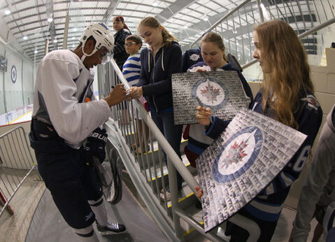 Winnipeg Jets left-winger Evander Kane stops to sign autographs after practising with teammates during an informal workout at the MTS Iceplex on Tuesday.