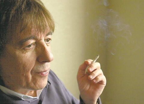 FILE--Former Rolling Stones bassist Bill Wyman is shown in Toronto, Thursday, Oct.31, 2002 promoting his new book. In the end, Wyman is not so unlike the rest of us. After leaving the Stones in 1992, following a three-decade stint as its bass player, Wyman, like so many of his fans, dreams of being a member of one of the greatest rock �n� roll bands of all time.,  which is a collection of memorabilia since the early 60's. (CP PHOTO/Globe and Mail/Louie Palu)