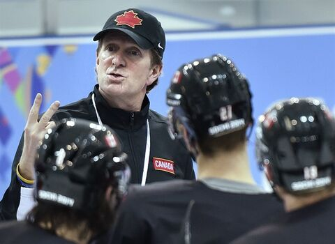 Canada's head coach Mike Babcock, back, explains a drill at hockey practice at the 2014 Sochi Winter Olympics in Sochi, Russia on Tuesday, February 18, 2014. THE CANADIAN PRESS/Nathan Denette