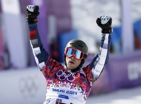 Russia's Vic Wild celebrates his win in a snowboard parallel slalom quarterfinal at the Rosa Khutor Extreme Park, at the 2014 Winter Olympics, Saturday, Feb. 22, 2014, in Krasnaya Polyana, Russia. (AP Photo/Andy Wong)
