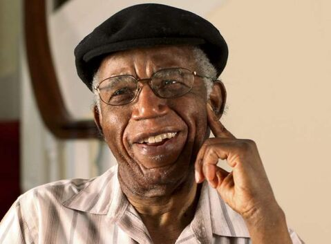 Chinua Achebe at home in photo  provided by Brown University.