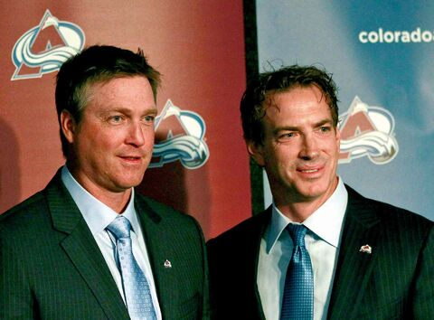 Colorado Avalanche coach Patrick Roy, left, and Joe Sakic